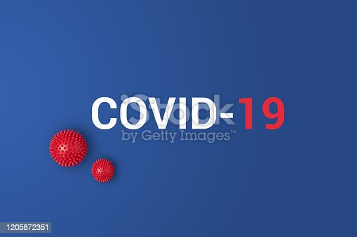 istock Iinscription COVID-19 on blue background with red ball 1205872351