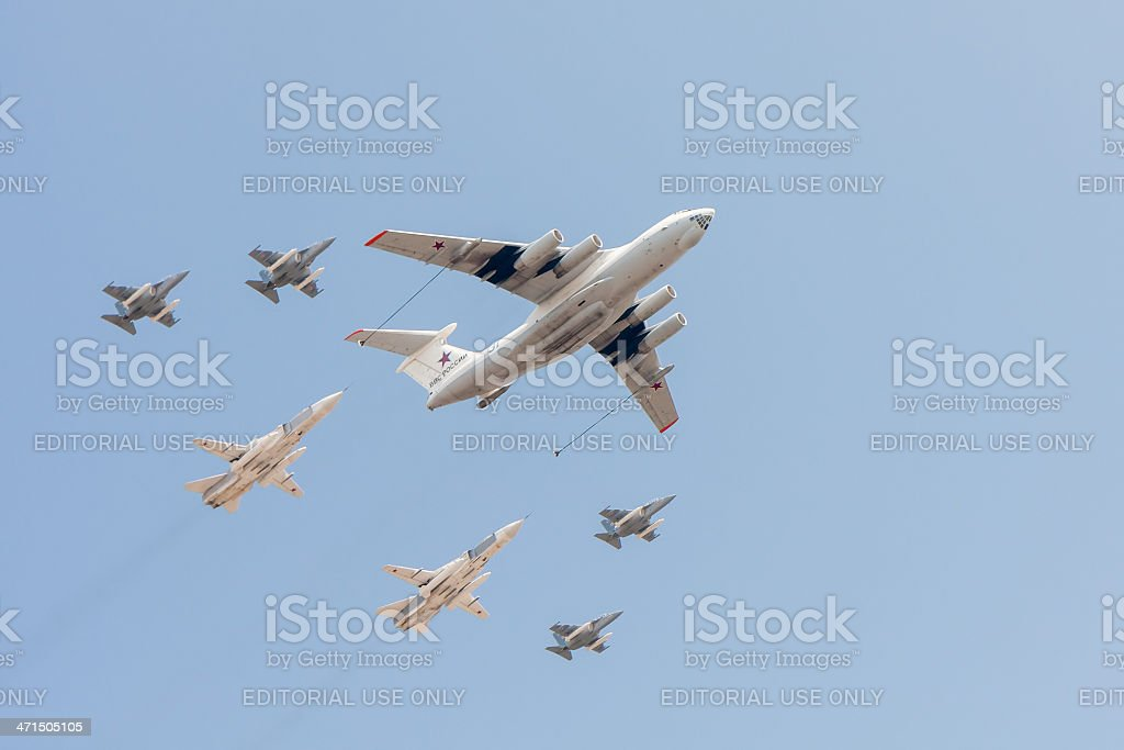 Il-78 refueling tanker, Su-24 and Yak-130 fly against sky background royalty-free stock photo