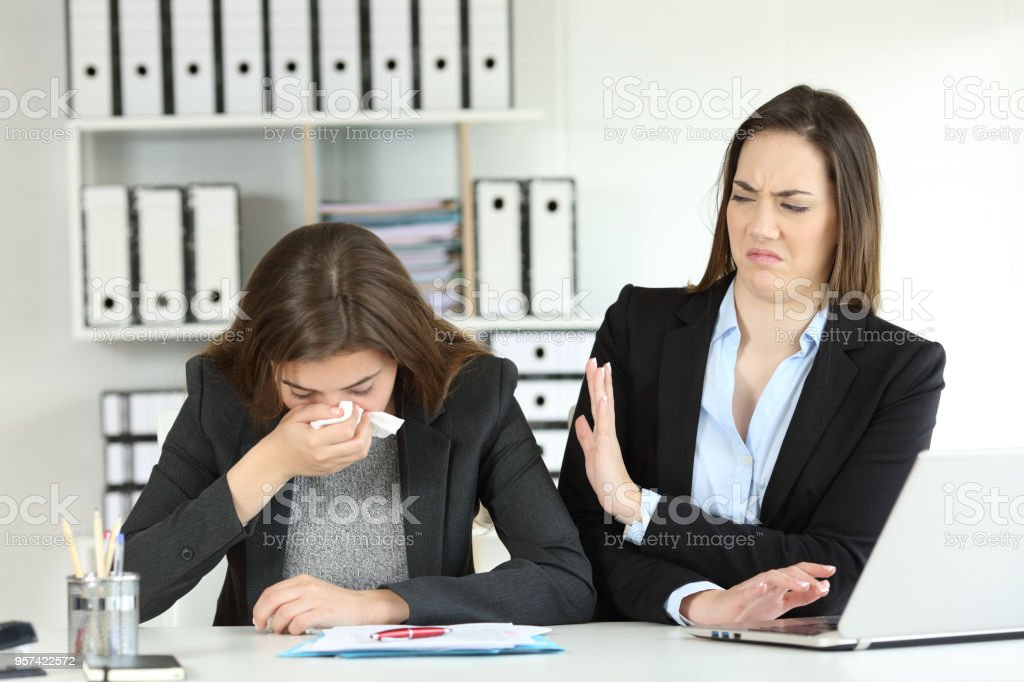 Ill businesswoman and a colleague rejecting her stock photo