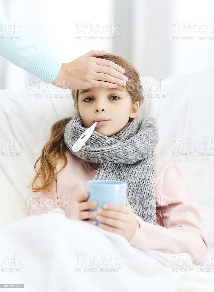 ill girl child with thermometer and caring mother stock photo
