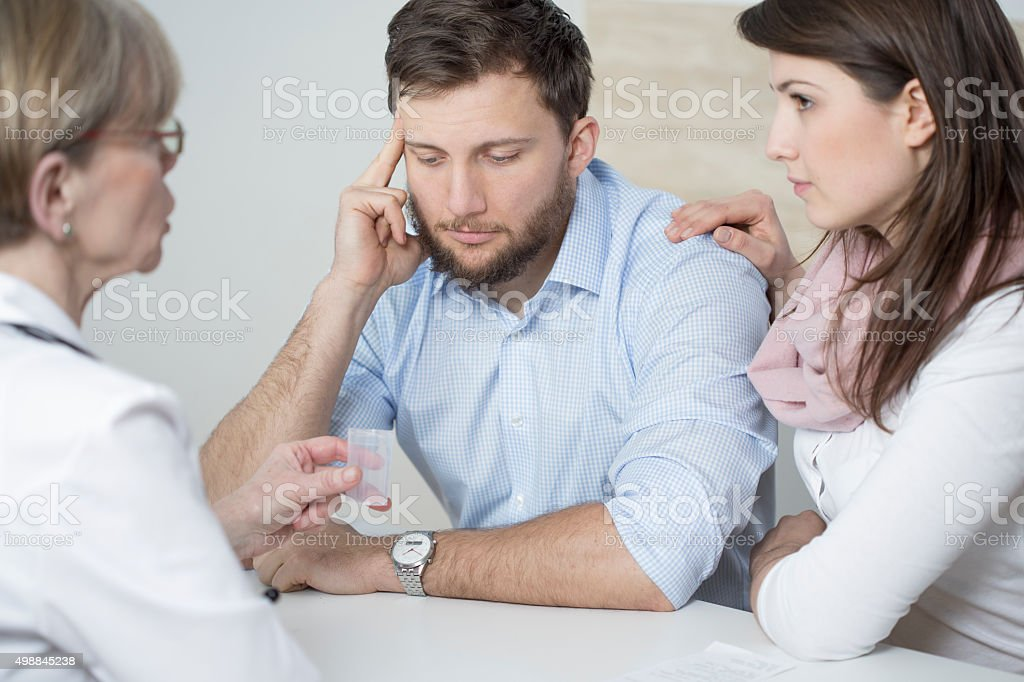 Ill man and assisting wife stock photo
