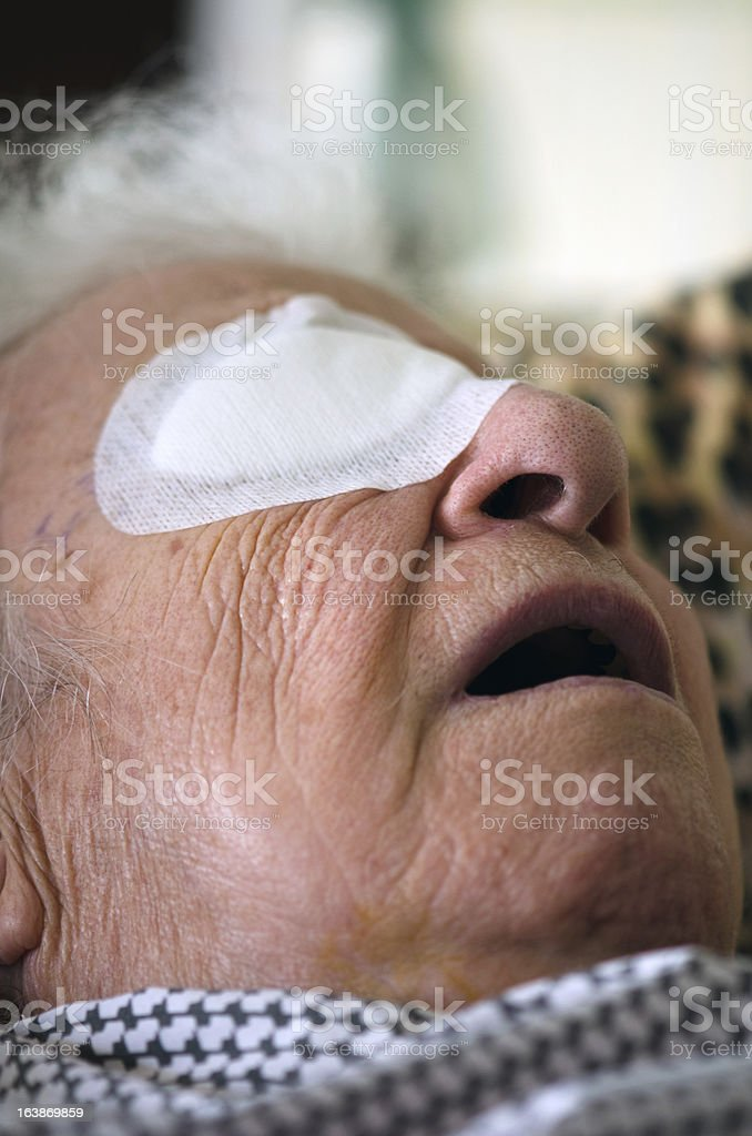 ill person with eye bandage royalty-free stock photo