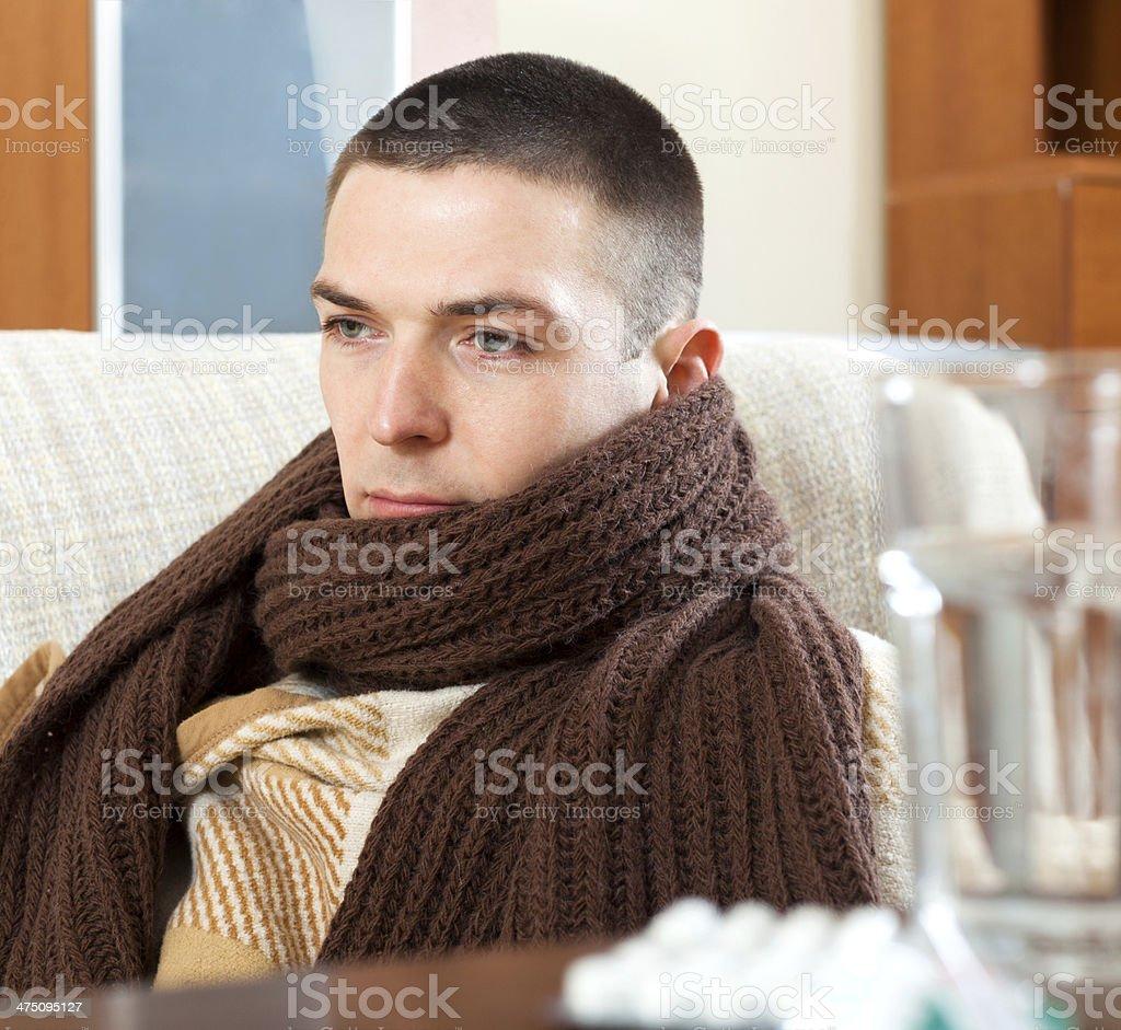 ill sad man in warm scarf royalty-free stock photo