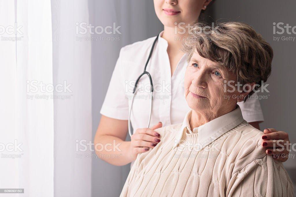 Ill senior and nurse stock photo