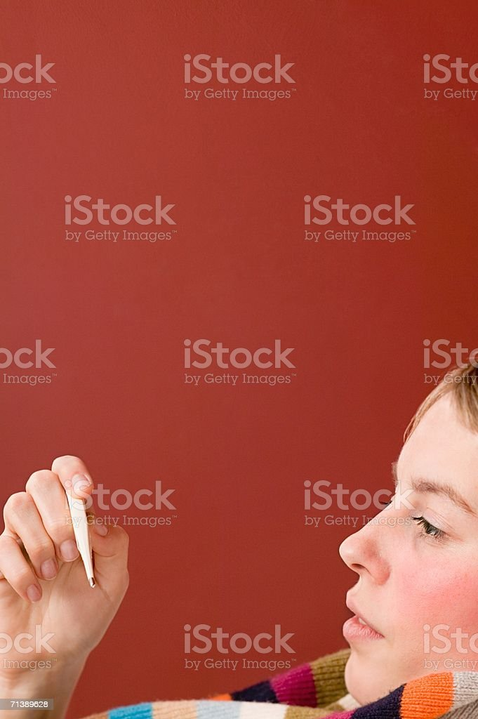 Ill woman holding a thermometer royalty-free stock photo