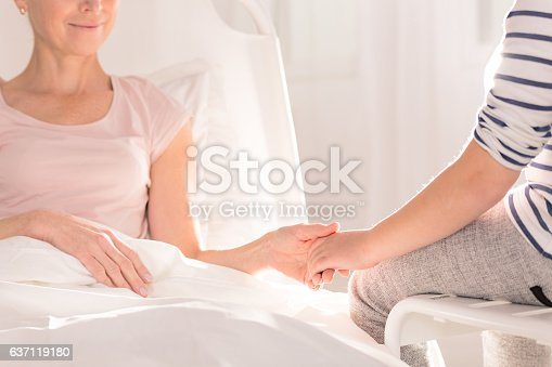 637119208 istock photo Ill woman holding child's hand 637119180