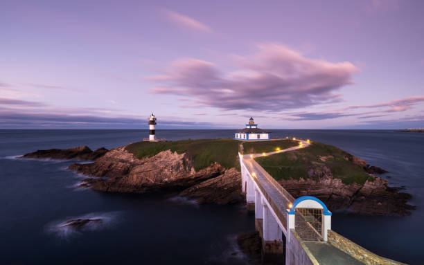 Illa Pancha island and lighthouse after sunset, Ribadeo, Galicia, Spain, Europe stock photo