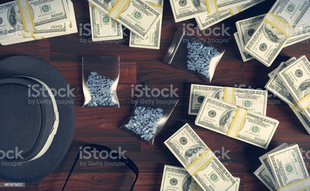 Illegal business drugs and dollars, Mafia drug dealer stock photo