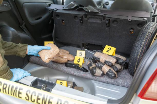 Illegal drug trade Drug bundles smuggled in a car trunk drug cartel stock pictures, royalty-free photos & images