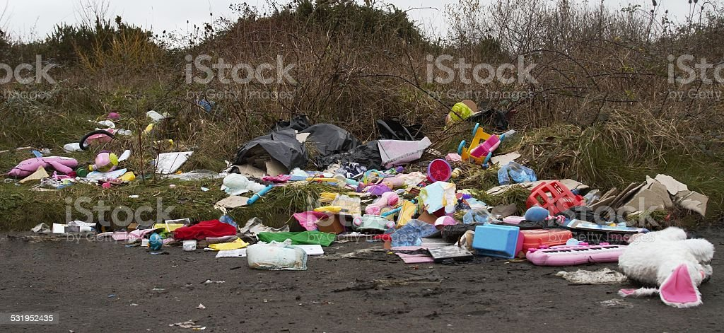 illegal dumping of rubbish by roadside stock photo