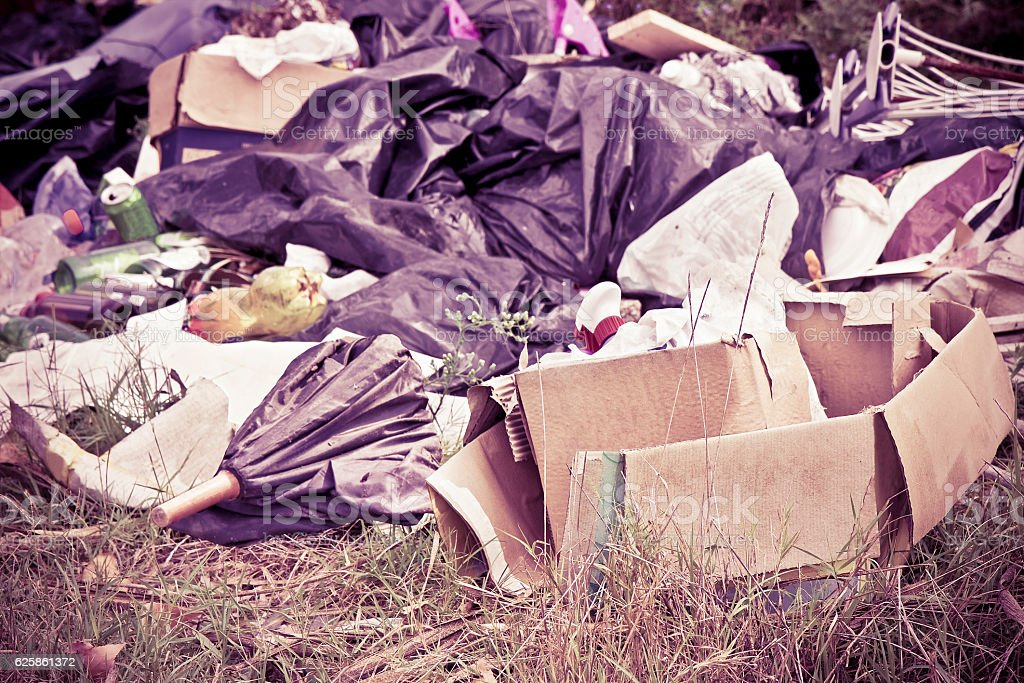 Illegal dumping - toned image stock photo