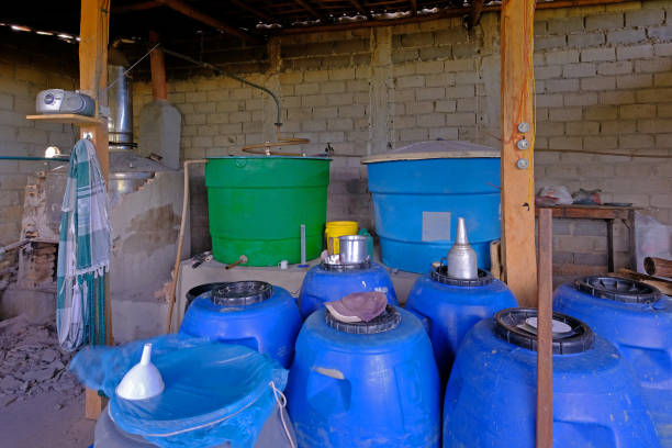 Illegal handmade artesanal sugar cane cachaca distillery near Santa Cruz Cabralia, Bahia, Brazil stock photo