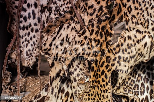 Close up on market stall with leopard skins