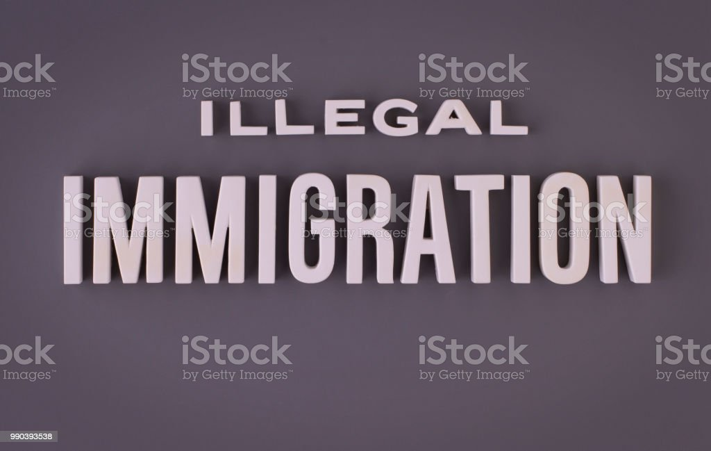 Illegal immigration lettering sign stock photo