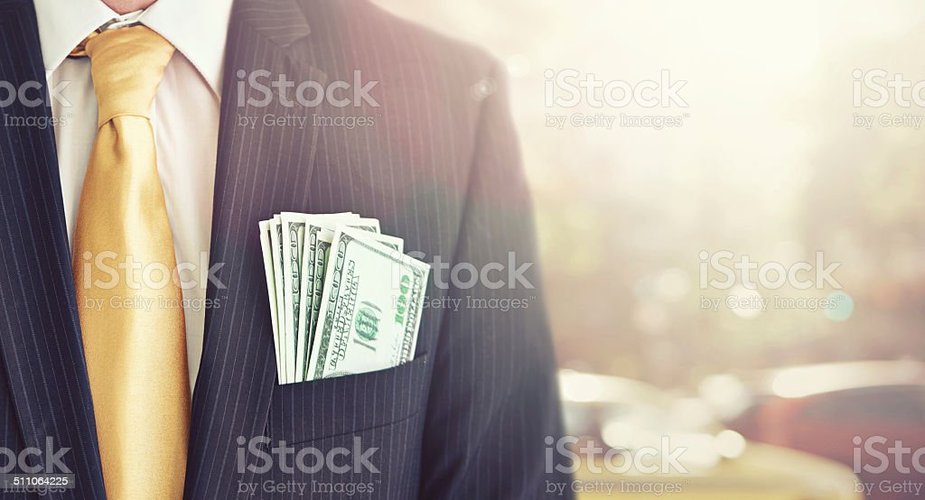 Illegal proceeds in his pocket stock photo
