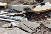 istock Illegal rubbish tipping on waste ground 1273482341