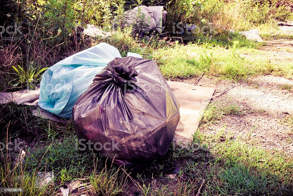 Illegally dumped rubbish in the country stock photo