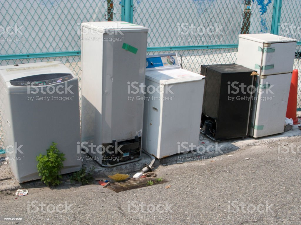 Illegally dumped washing machine stock photo