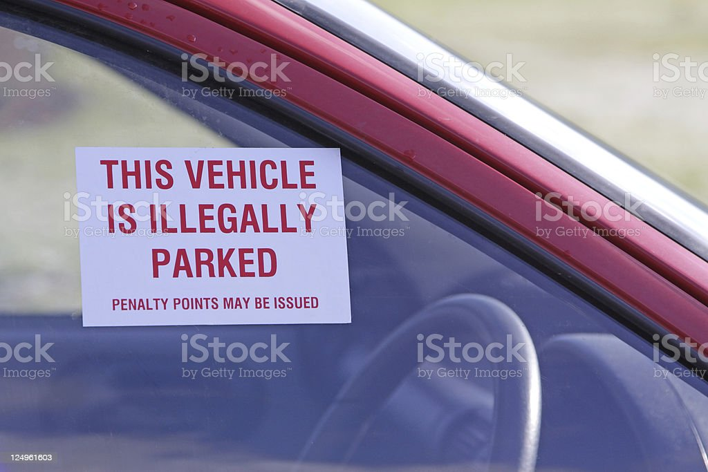 illegally parked car stock photo