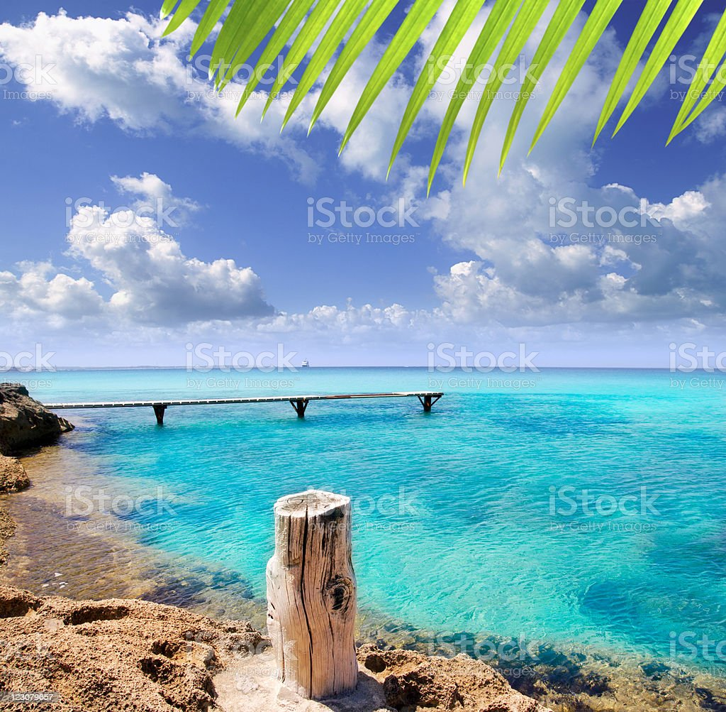 illetes wooden pier turquoise sea Formentera stock photo