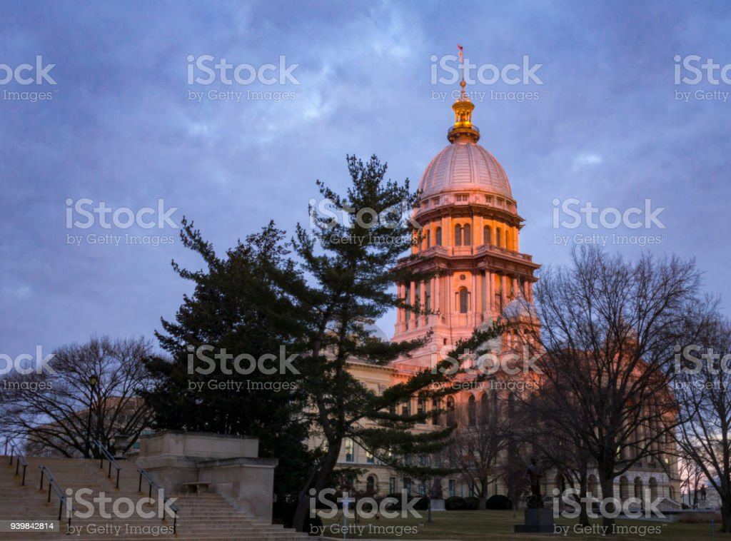 Illinois State Capitol building at sunrise with trees in Springfield Illinois stock photo