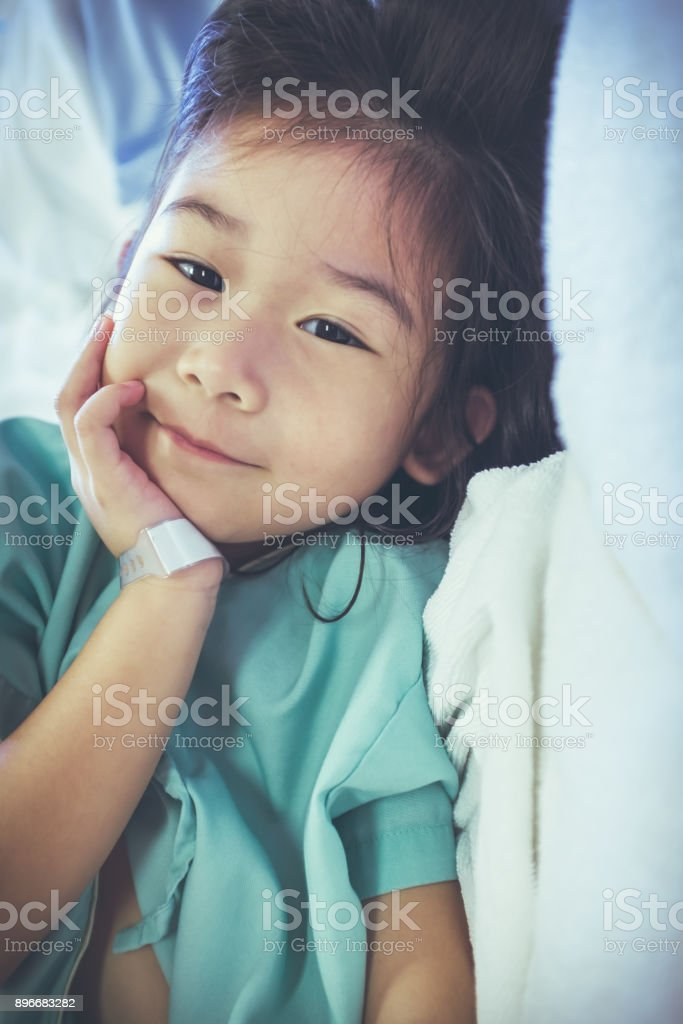 Illness asian child admitted in hospital. Health care stories. Vintage tone. stock photo