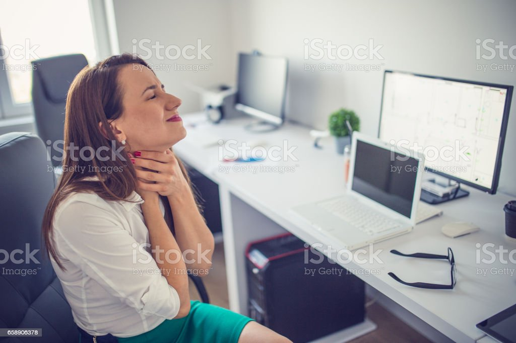Illness in office stock photo