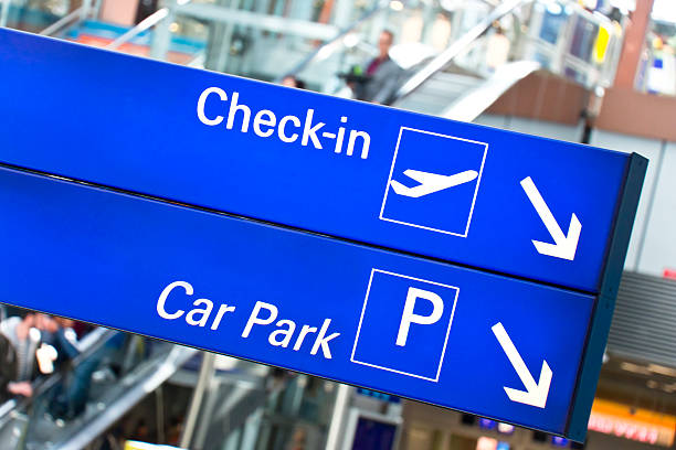 Illuminated Airport Sign Check-In and Car Park stock photo
