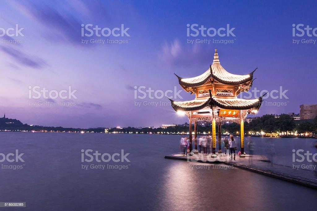 illuminated ancient chinese pavilion in west lake,Hangzhou,china stock photo