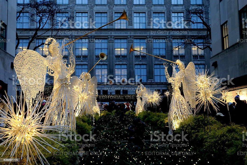 Illuminated Angels at Rockefeller center and Saks Fifth Avenue. stock photo