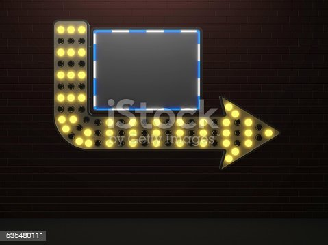 istock Illuminated arrow sign with blank board and light bulbs 535480111