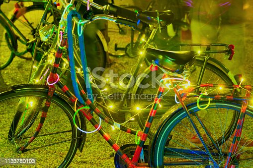 illuminated bicycles at night in Amsterdam, The Netherlands