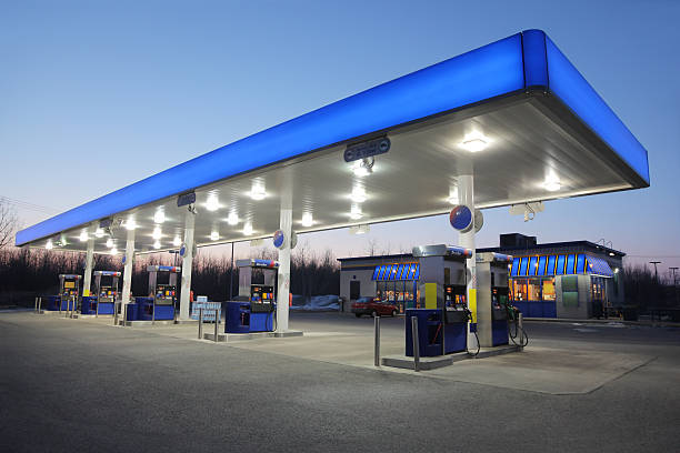 Illuminated Blue Gas Station at Sunset stock photo