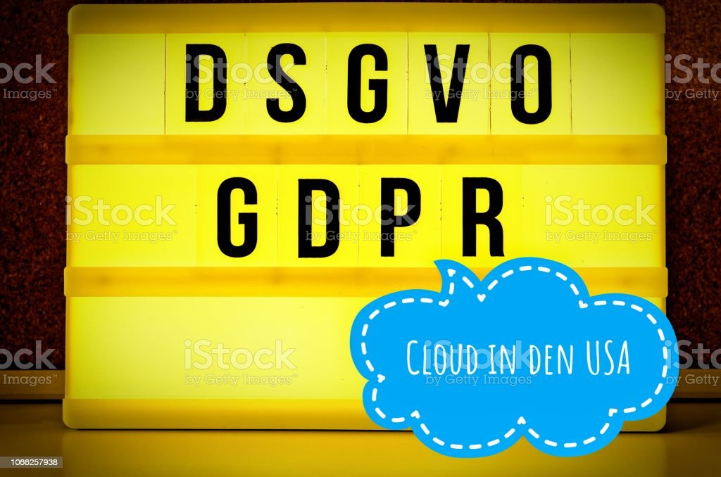 Illuminated board with the inscription DSGVO and GDPR (General Data Protection Regulation) purple in English GDPR (General Data Protection Regulation) and the inscription Cloud in den USA in English: Cloud in the USA stock photo