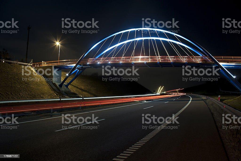 Illuminated bridge at night on the speedway royalty-free stock photo