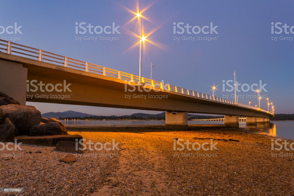 Illuminated bridge at night stock photo