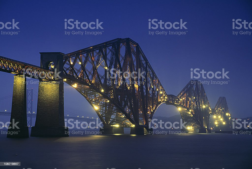 Illuminated Bridge Over Water at Night royalty-free stock photo