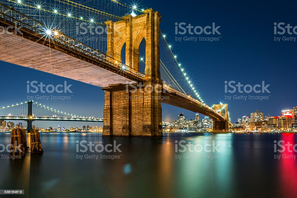 Illuminated Brooklyn Bridge by night stock photo