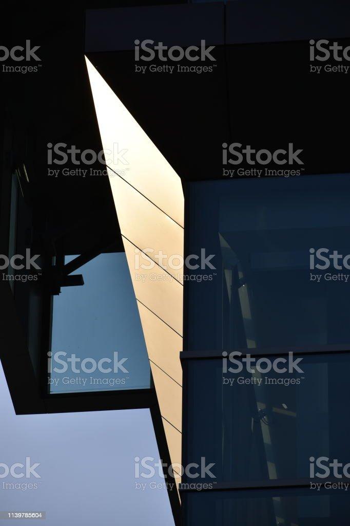 Illuminated Building Corner Close-up stock photo
