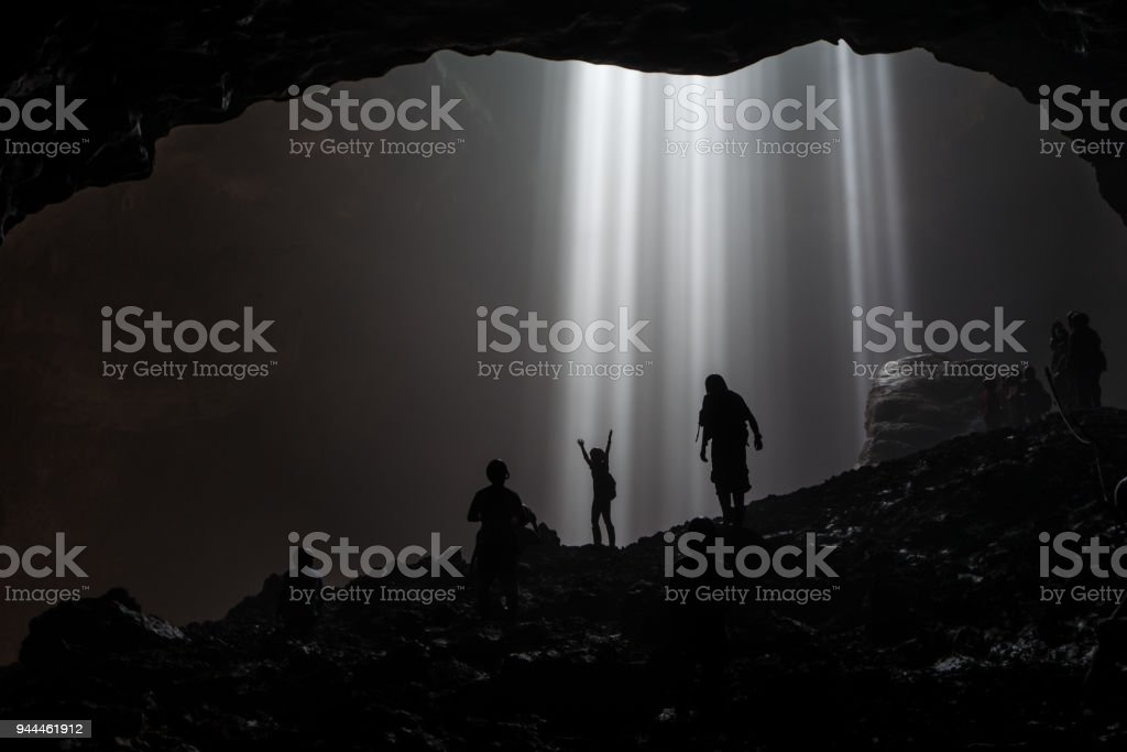Illuminated cave at Goa Jomblang Tour near Yogyakarta, Indonesia stock photo