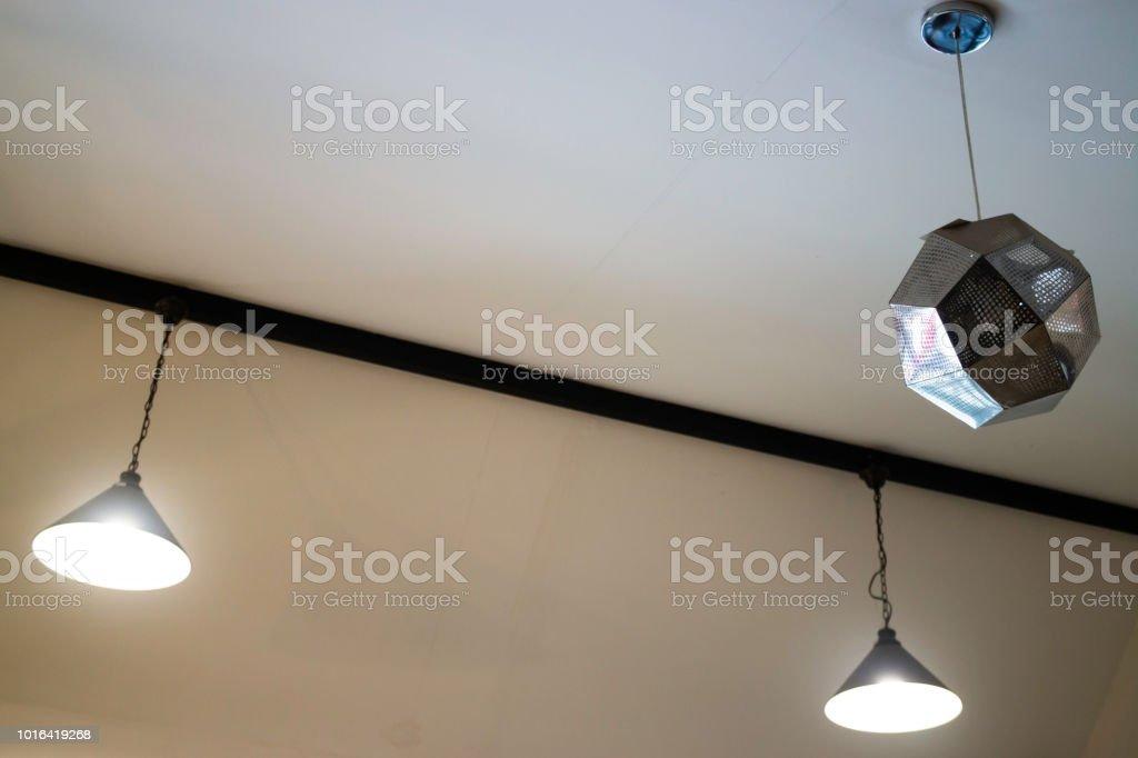 Illuminated ceiling warm light lamp, stock photo
