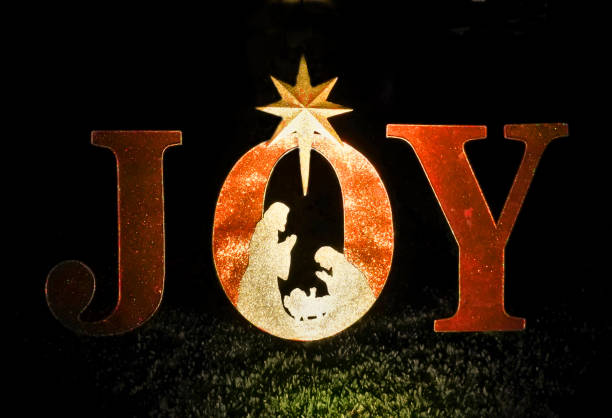 illuminated christmas letters spelling joy - nativity scene stock pictures, royalty-free photos & images