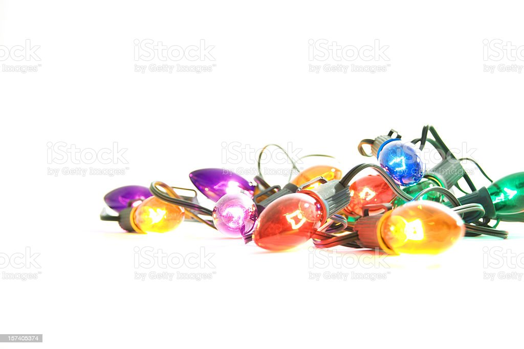 Illuminated Christmas Lights on White Background stock photo