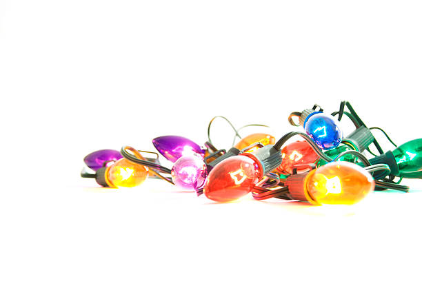 Illuminated Christmas Lights on White Background stock photo