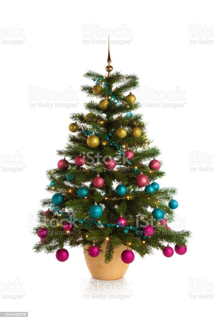 Illuminated Christmas tree isolated on white stock photo
