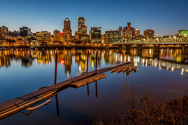 Illuminated Cityscape  Reflections Portland Oregon Skyline Willamette River Boat Dock stock photo