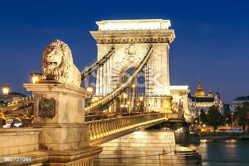 Illuminated close-up view of Szechenyi Chain Bridge and St Stephen's Basilica in Budapest at night