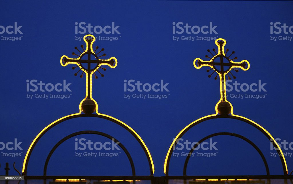 Illuminated cross on a gate royalty-free stock photo