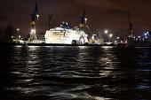 Illuminated cruise liner in dry dock in port of Hamburg