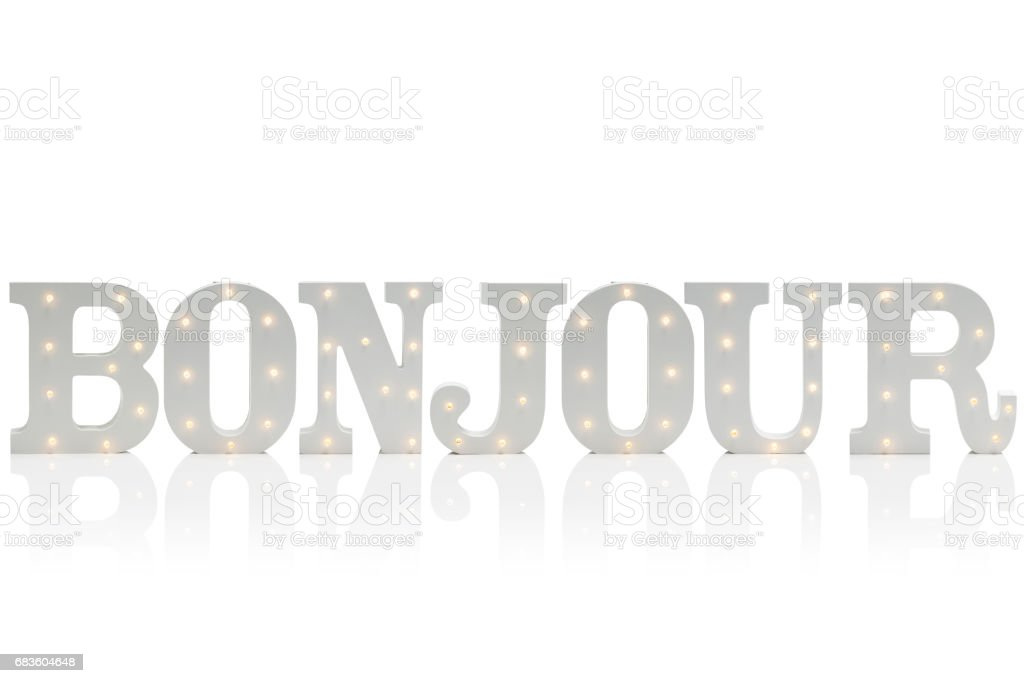 Illuminated Decorative Letters Spelling BONJOUR Over White Background stock photo